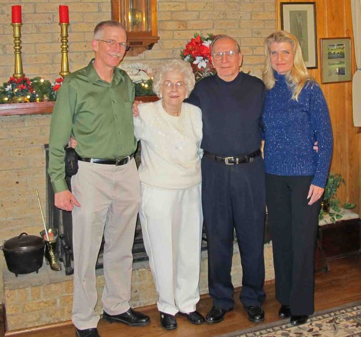 My parents flanked by me and my sister.