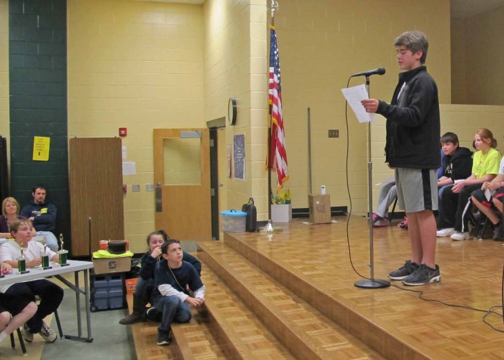 Student performing his poem at the slam.