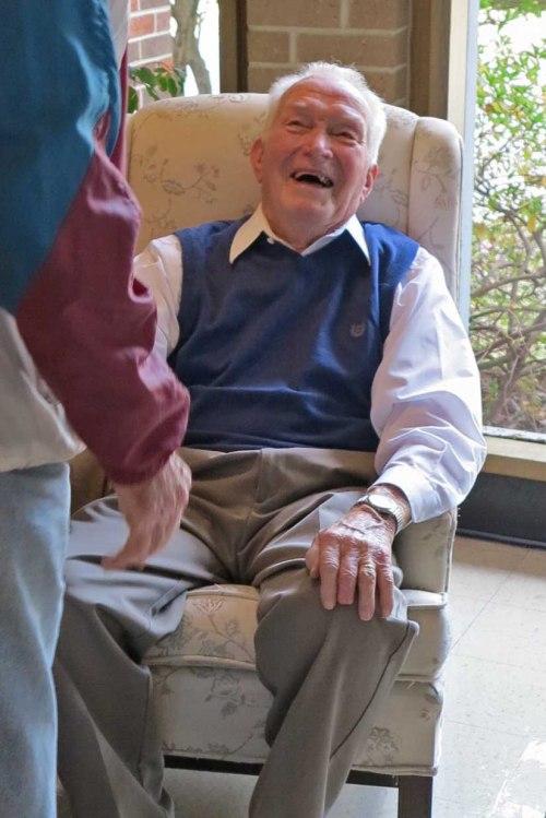Tom Bensberg greeting visitors at his 90th Birthday celebration.