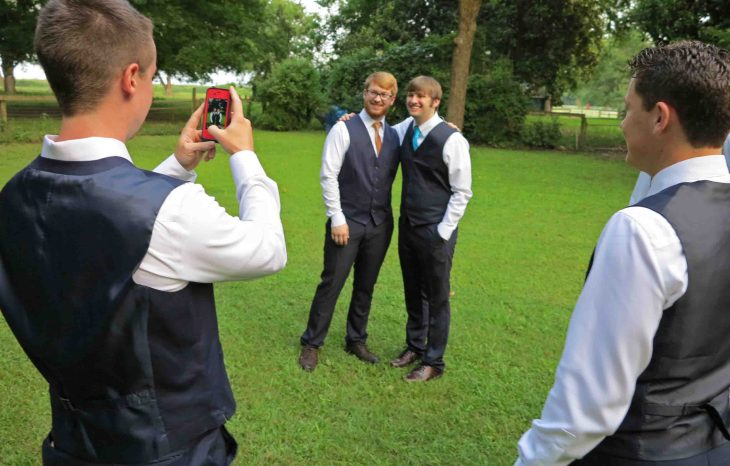 Garrett, Taylor's older brother, taking pictures of Taylor and his friends.